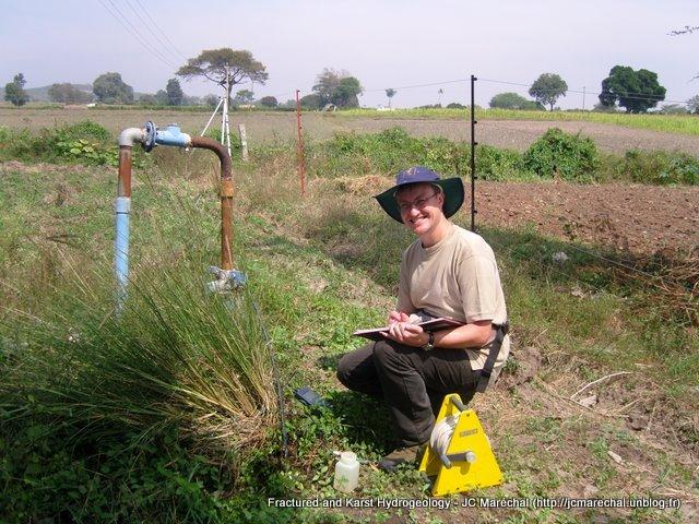Sampling an artesian well in Maddur Watershed